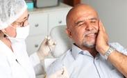 почему может болеть зуб под коронкой